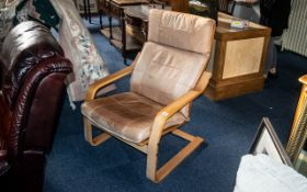 Designer Bentwood Danish Armchair covered in a tan leather loose back and seat covering.
