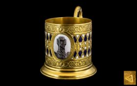 Russian Antique Gilt Metal Glass Tea Cup Holder, finely decorated in raised blue and white enamels,