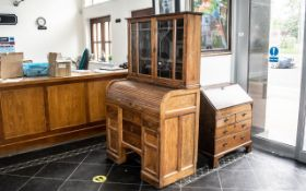 A Small Golden Oak Tambour Fronted Fitted Roll Top Desk, with a matching leaded glass cupboard