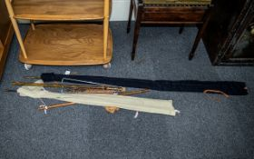 Two Unmarked Cane Two Piece Fishing Rods, both in canvas holders,
