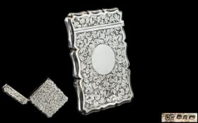 Early 20th Century Sterling Silver Hinged Card Case with Chased Floral Decoration to all Parts,