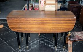 G Plan Tola Drop Leaf Dining Table, 1950's ebonised legs with brass casters.