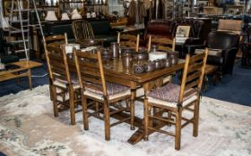 Reproduction Oak Cottage Dining Room Suite comprising a traditional draw-leaf table supported on