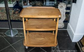 """Ercol Three Tier Trolley, with chamfered galleries, on turned supports. Height 30"""", 28"""" x 18""""."""