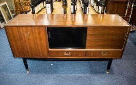 G-Plan Tola Teak Sideboard, circa 1950's ebonised legs, sliding doors and two short drawers,