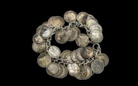 Silver Charm Bracelet with over forty silver threepenny pieces attached; weighs 3oz (app.