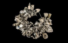 Superb Vintage Sterling Silver Charm Bracelet Loaded with Over 65 Charms. All Marked for Silver 925.