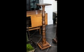 A Late Victorian Mahogany Pedestal with a turned column terminating on a stepped square base. Height