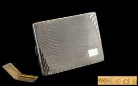 Art Deco Designed Bright Cut Sterling Silver Cigarette Case with Gilt Interior.