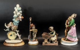 Four Pieces of Capodimonte, a schoolchild at desk, a clown with balloons, a couple dancing,