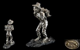 Silver Overlaid Figure of a Man Carrying a Bundle of Wood, stamped 999 'Zampeld',
