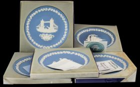 Wedgwood Blue Jasper Early Edition Christmas Plates, comprising 1972/73/74/75 and 1976.