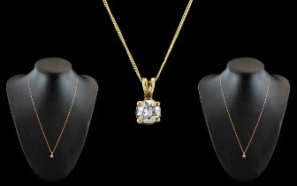 A Fine 18ct Gold Single Stone Diamond Set Pendant, Attached to a 9ct Gold Chain. The Modern Round