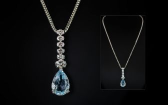 Ladies - Stunning 18ct White Gold Diamond and Blue Topaz Set Pendant Drop. Attached to a 18ct