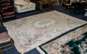 Large Beige Ground Embossed Chinese Florally Decorated Carpet; in good condition, 103 inches (257.