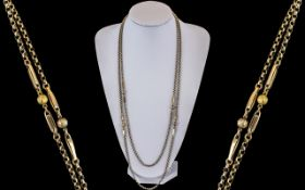 Antique Period Excellent Quality 9ct Gold Muff Chain of Long Length. Marked 9ct Gold. c.1890 - 1900.