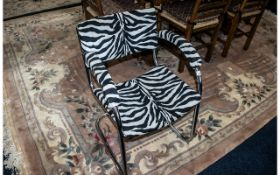 A Pel Chrome Cantilever Bauhaus Style Armchair. Covered in zebra print fabric.