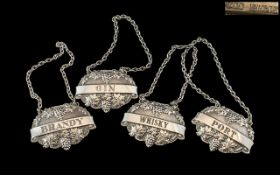 A Superb Set of Four Sterling Silver Decanted Spirit Labels, Each Decorated with a Fruiting Vine and