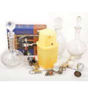 Three cut glass decanters and selection of bottle openers, corkscrews, and kitchenalia.