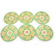A set of six Wedgwood wall plates, retailed by Goode & Son