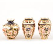 A pair of Royal Crown Derby Imari design miniature ovoid vases, and a miniature swollen vase.