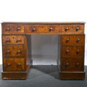 A Victorian burr walnut twin pedestal desk.