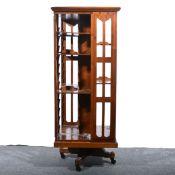 An Edwardian walnut revolving bookcase.