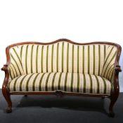 A Victorian walnut framed sofa.