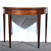 A George III mahogany demi lune tea table.