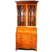 A George III mahogany bureau bookcase.
