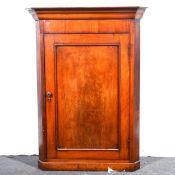 A Victorian mahogany hanging corner cupboard.