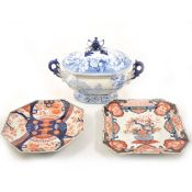 A Staffordshire blue and white transfer printed tureen, and two Imari plates.