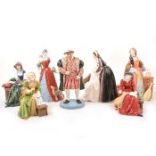 Royal Doulton figures of King Henry VIII and his wives.