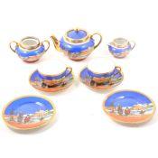 Continental porcelain tea service with an Arabian desert scene.