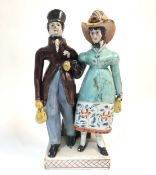 A Staffordshire pearlware group of Dandies, early 19th century.