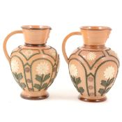 Pair of Doulton Lambeth Slater's patent Aesthetic style stoneware jugs.