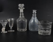 A pair of Regency style mallet-shape decanters, plus other decanters and wine glasses.