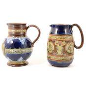 Doulton Lambeth and Royal Doulton stoneware commemorative jugs.