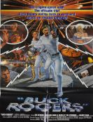 Two Buck Rogers (1979) movie posters and three lobby cards.
