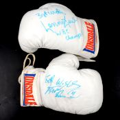 Pair of signed boxing gloves.