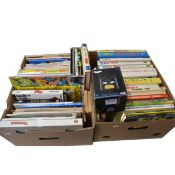 Two boxes of graphic novels and comic books.