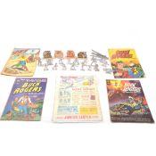 Buck Roger comics and cast figures.