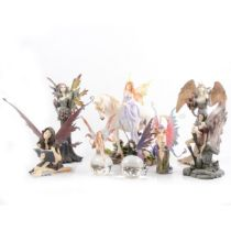 Nemesis Now fairy figures and glass paperweights.