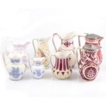 Eight Victorian relief-moulded jugs.