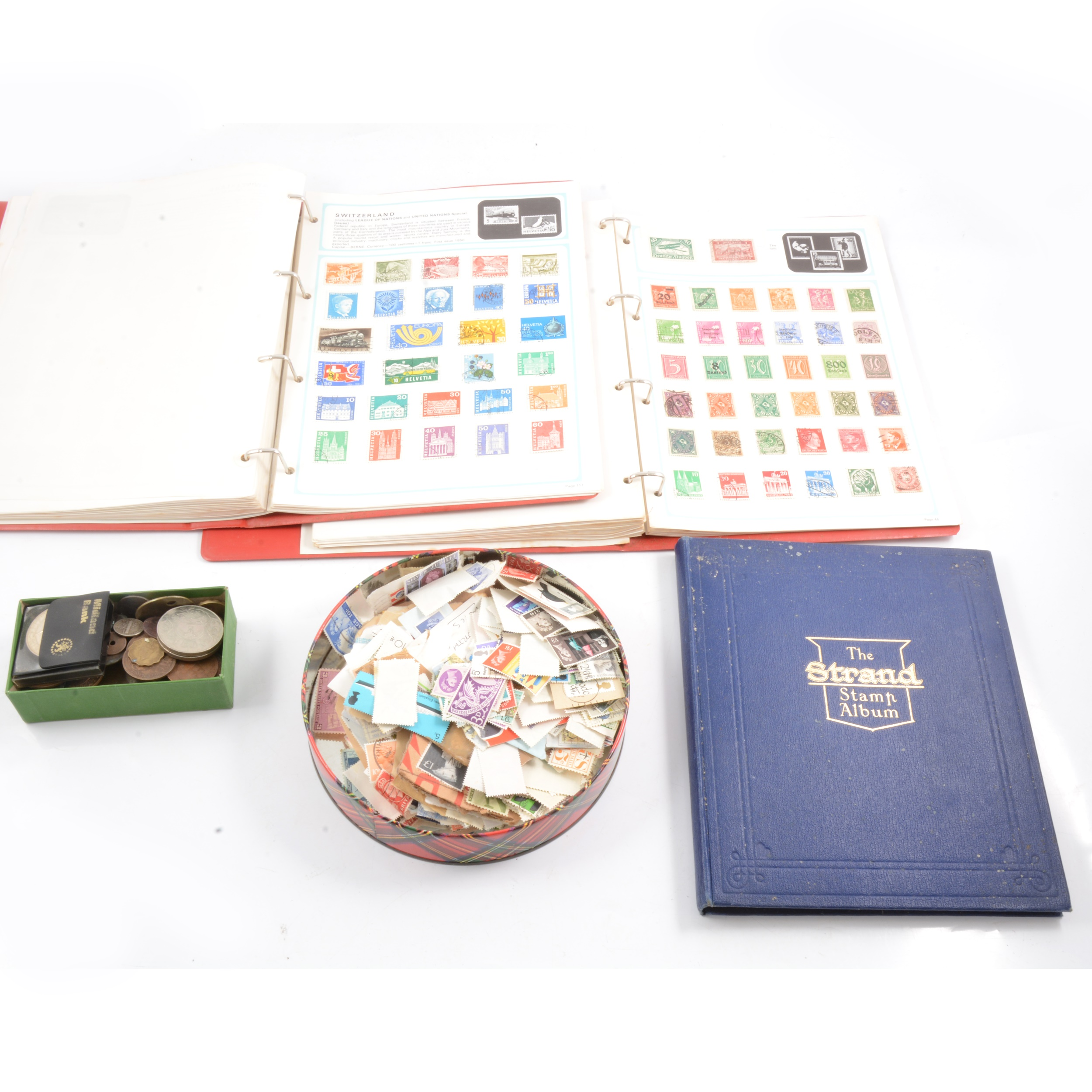 Collection of stamps and coins.