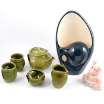 Holkham Pottery blue and cream lamp base, green glazed two person tea set, Wade pig.