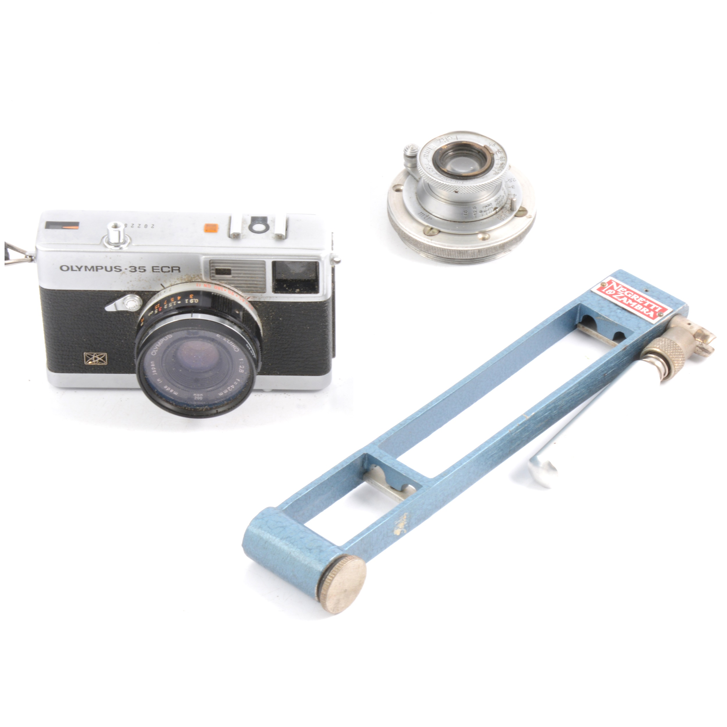 Olympus camera, Leitz Elmar lens, and a hygrometer.