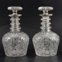 Pair of crystal decanters with silver collars, John Round & Son Ltd, Sheffield 1926.