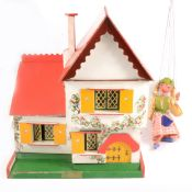 Swedish chalet doll's house and a Pelham Puppet,