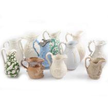 Eleven assorted Victorian decorative jugs